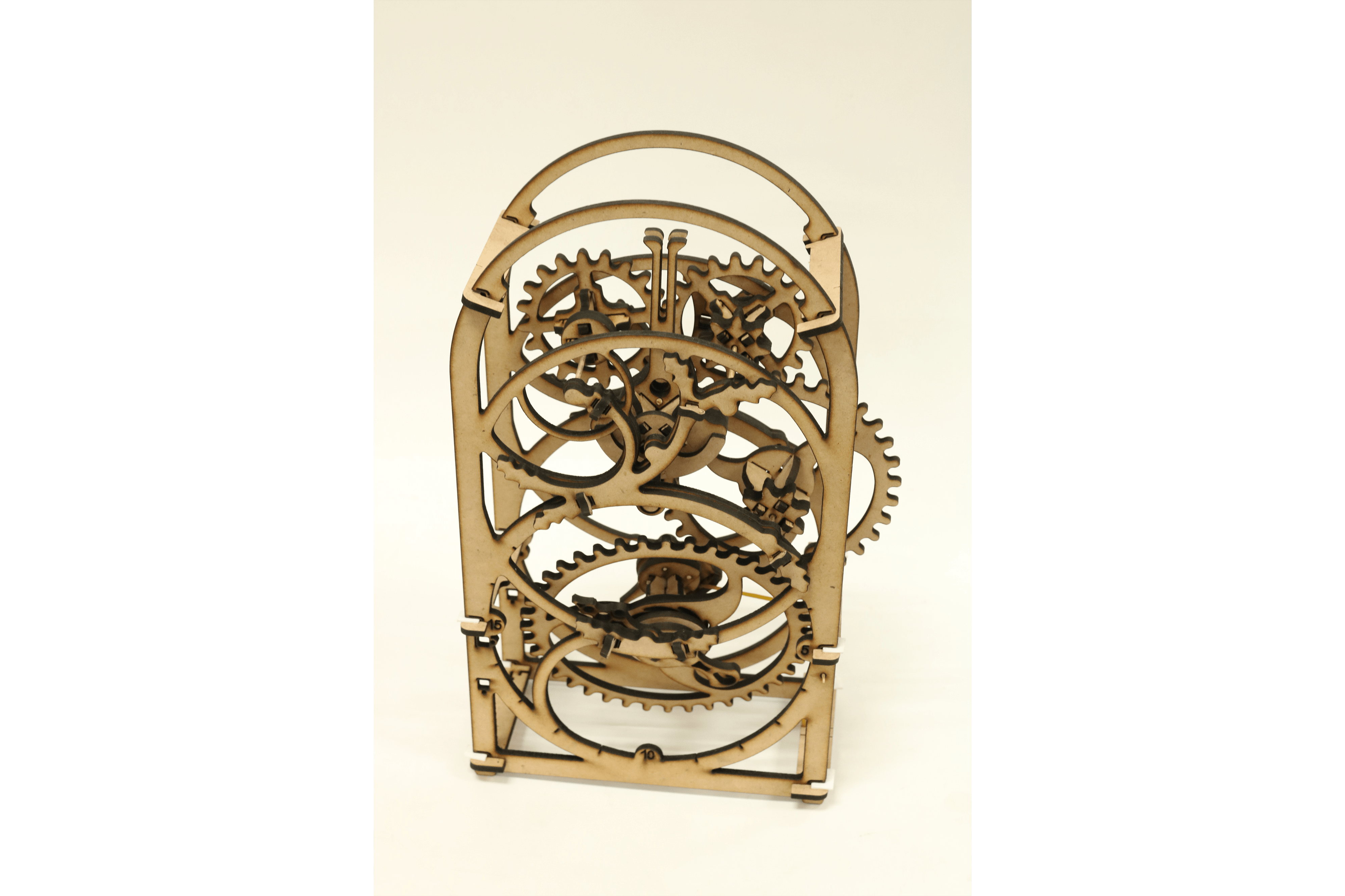 A scale model for a kinetic sculpture made of intricately lasercut MDF pieces. (By: Marvie Gasataya)